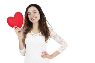 Smiling valentines day woman showing a red heart