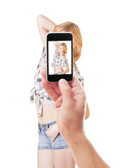 photographing girl smartphone on a white background isolated