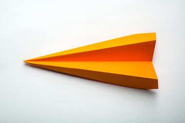orange origami paper airplane