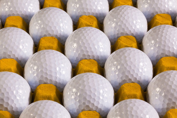 Golf balls in box for eggs