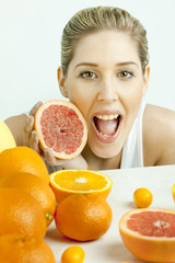 portrait of young woman with grapefruit