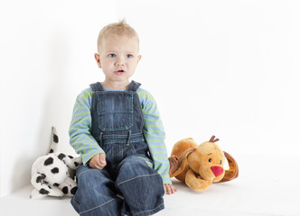 sitting toddler with toys