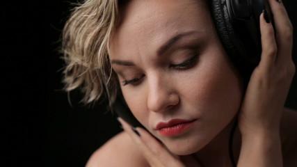 Woman blonde closeup listening to music.