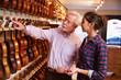 Salesman Advising Customer Buying Violin - 75695796