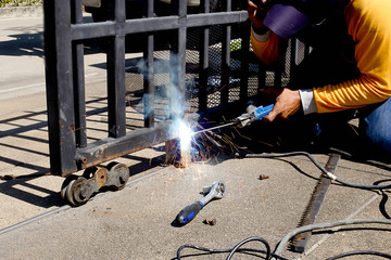 Welder making a fence roller