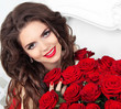 Beauty model girl with makeup, long hair and beautiful red roses