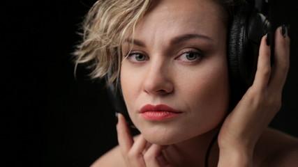 Portrait of beautiful girl in headphones.