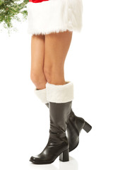 Female legs in santa boots