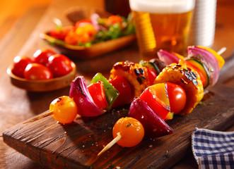 Colorful vegetarian kebabs with fresh veggies