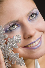 portrait of woman with snowflake