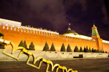 red brick wall of the Kremlin with night illumination