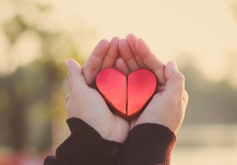 heart in hand sunset beach romantic feeling