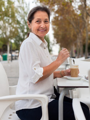 cute mature woman at coffee shop.