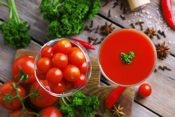 Tomato juice in goblet and fresh vegetables