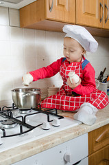 Little cook adds spice to the pot of soup
