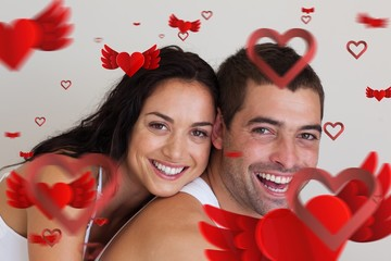 Composite image of young couple smiling at camera
