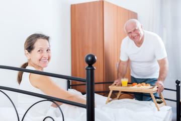 husband brings his wife breakfast i