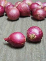 Red onions on wooden background