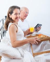 couple having breakfast in bed.