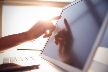 Close Up Hand Touching Laptop Screen With Lens Flare