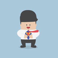 Young businessman tearing his shirt and showing the superhero su