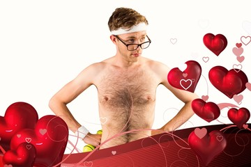 Composite image of geeky shirtless hipster posing with dumbbell