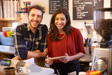 Portrait Of Couple Running Coffee Shop Together