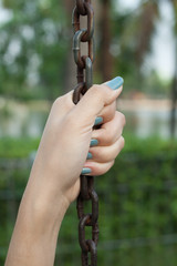 Woman holding chain