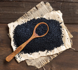 Nigella sativa or Black cumin with a spoon