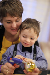 Mother and son making Christmas toy