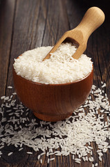 Bowl and wooden spoon with rice