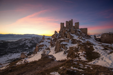 Panoramic view of Rocca Calascio in winter time with dramatic sk