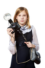 Girl reporter photographer with retro camera and flash