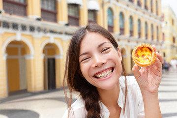 Local Macau food - woman showing Pastel de nata