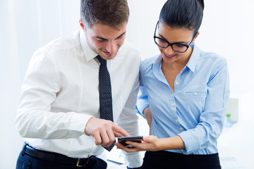 Business people working in the office with mobile phone.