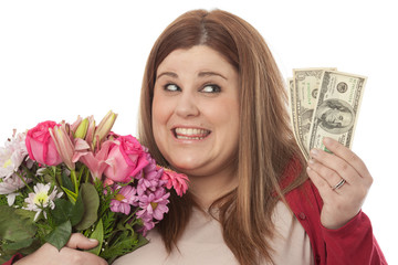 Selfish woman holding flowers and dollars