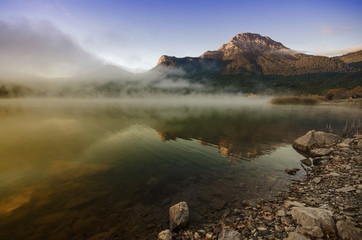 Sunrise with mist over a lake