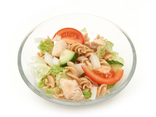 Pasta salad with chicken in a glass bowl