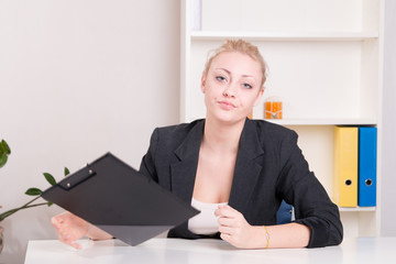 Dissatisfied employer woman during interview at office