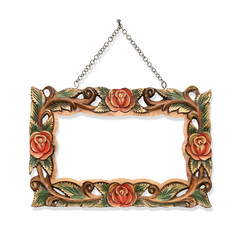 wooden frame carved with chain hanging on white