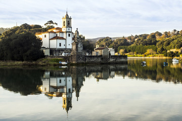 Church and bay in the Spanish town of Niembro (Llanes-Asturias)