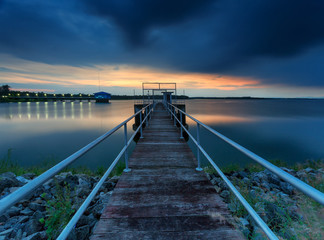 The long bridge toward to pump house at reservoir ,Thailand