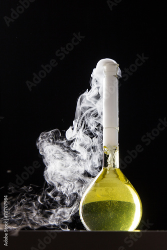 Chemical reaction in volumetric flask glass in labolatory - 75707984