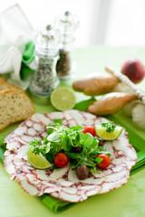 Octopus Carpaccio with mixed salad