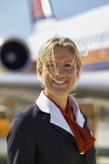 Italy, Sardinia, Olbia Airport, flight stewardess portrait