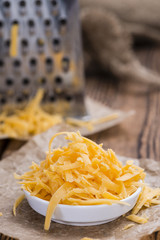 Grated Cheddar in a bowl
