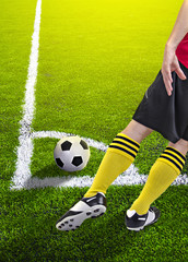 Soccer player in a corner kick