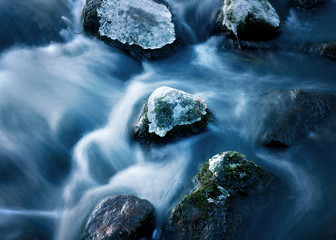 Rock in streaming water