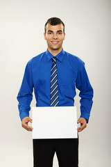 Businessman holds white paper, you can write some text