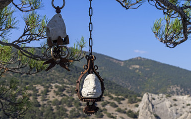 Two stone idol on the branches of pine tree